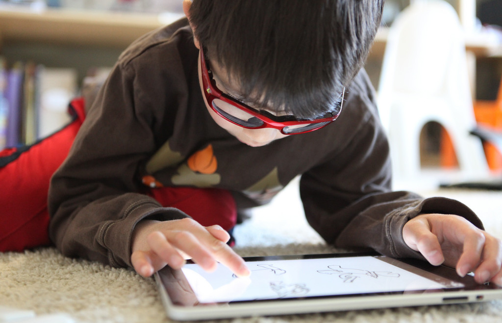 Kobe drawing on the iPad using Adobe ideas. Mixed reviews, he's getting a little frustrated with the controls, sometimes it' pans when it should be drawing, sometimes it doesn't let you draw over something you've already drawn....